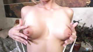 Hot blonde Kate England squeezes her puffy nipples and strips nicely