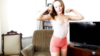 Petite brunette prostitute Aubrey Star strips and shows her tits