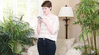 Cute brunette Emma Snow with short hair poses with telephone solo
