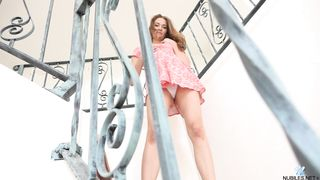 Pretty brunette Samantha Hayes in cute dress stretches her clit solo