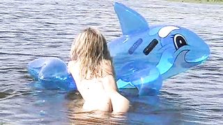 Teen blonde naked Valentina B.swims with cute toy and shows her ass
