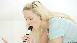 Petite blonde Melanie masturbates using a nice vibrator